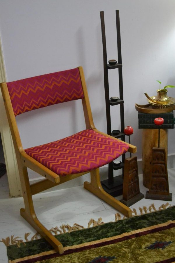 A vintage chair upholstered in pink and orange cheveron fabric from fab indial