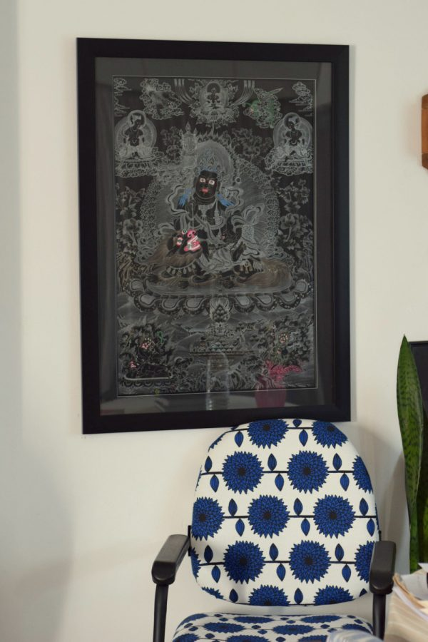 A black and white Kuber Thangka against my newly upholstered chair.