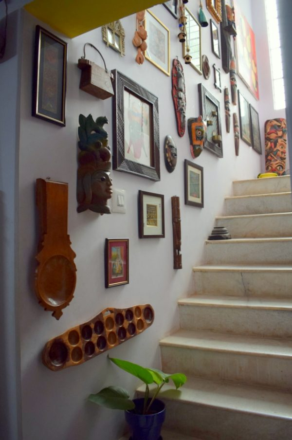A gallery wall with indian vintage elements