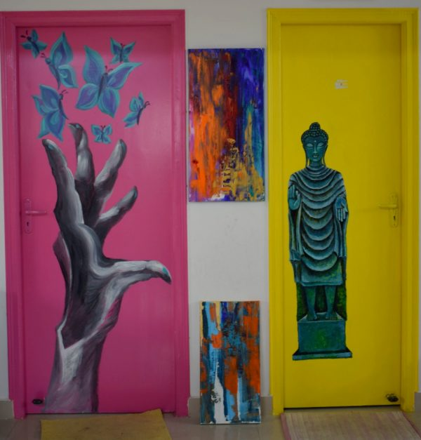 Pink and yellow doors with mural