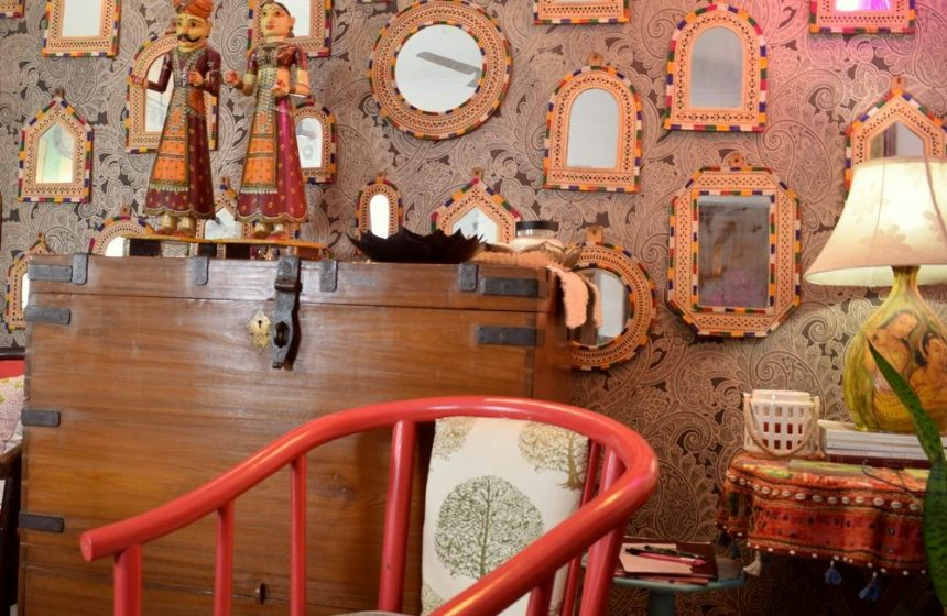 A stunning wall of mirrors styled with period furniture and the finest indian handmade.