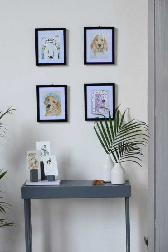Gallery wall with cats and dog potrait